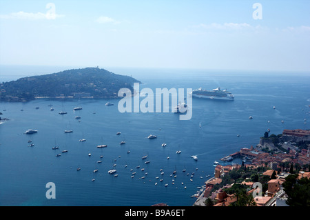 The natural harbor of Antibe with Cruise liner in the picture with small sailing craft and a superyacht - Stock Photo
