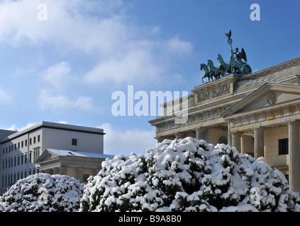 Berlin Paris square brandenburg gate quadriga with snow - Stock Photo