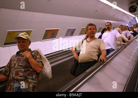 People on an escalator to the metro in Budapest, Budapest, Hungary - Stock Photo