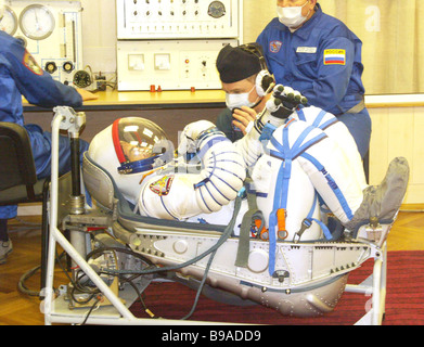 Ship Commander Pavel Vinogradov trying on a spacesuit On the Baikonur cosmodrome the flight and stand by crews of - Stock Photo