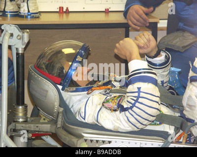 Brazil s first astronaut Marcos Pontes trying on a spacesuit On the Baikonur cosmodrome the flight and stand by - Stock Photo
