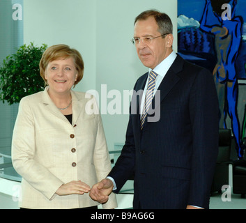 Angela Merkel Federal Chancellor of Germany and Sergei Lavrov Russia s Foreign Minister meet in Berlin - Stock Photo