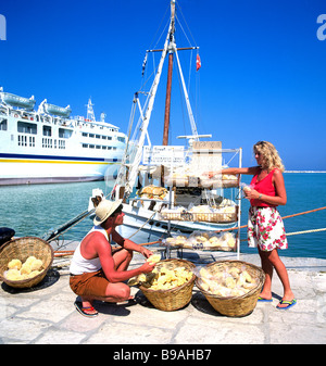 greece dodecanese cos tourists buying sponges at kardamena - Stock Photo