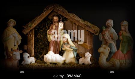 Christmas nativity scene with china figures - Stock Photo