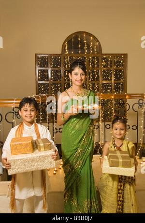 Family celebrating Diwali - Stock Photo
