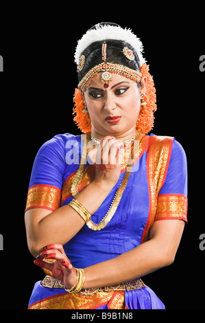 South Indian Woman performing Bharatnatyam the classical dance of India - Stock Photo