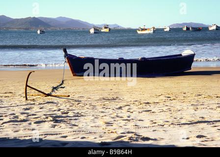 FIshing boat on the sand, Armacao do Pantano do Sul, Florianopolis, Santa Catarina, Brazil - Stock Photo