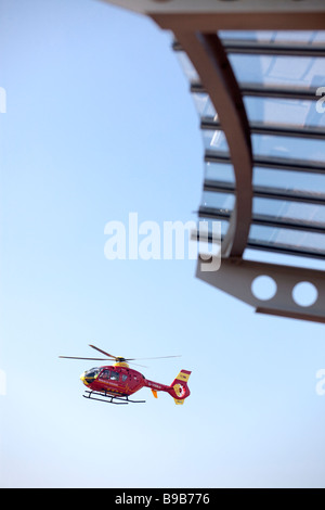 An air ambulance helicopter lands at Selly Oak Hospital Birmingham West Midlands ENgland - Stock Photo