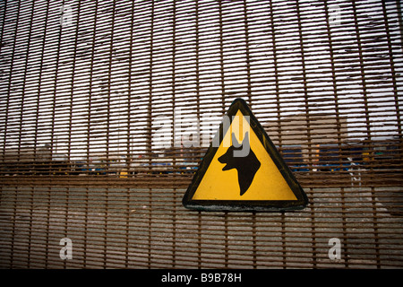 Warning guard dog sign on the perimeter fence of the Sellafield Nuclear plant Cumbria England UK - Stock Photo
