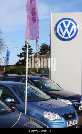 A VW dealership in a U.K. city. - Stock Photo