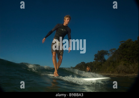 skinny young surfer - Stock Photo