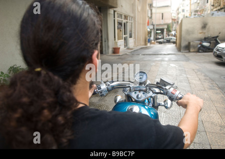 Rear view of a young man riding a motorbike in Beirut Lebanon Middle East Asia - Stock Photo