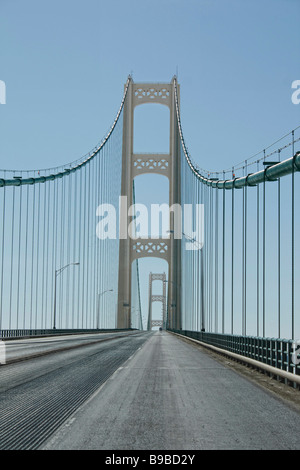 Modern big Mackinac bridge in Michigan USA no not people nobody isolated on blue sky background close up closeup - Stock Photo