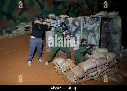 Three young men playing paintball Beirut Lebanon Middle East - Stock Photo
