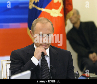 Russian President Vladimir Putin answers questions during live television hook up on Rossia and ORT channels The - Stock Photo