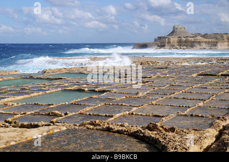 Salt evaporation ponds off the coast of Gozo - Stock Photo