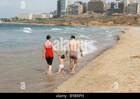 Lebanese family walking on the beach in Beirut Lebanon Middle East Asia - Stock Photo