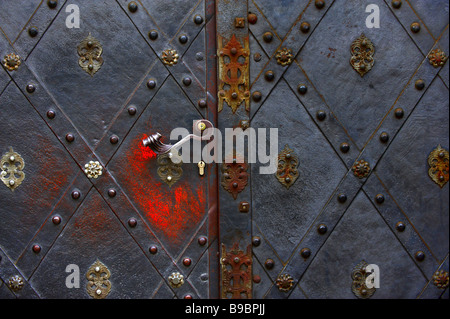 Part of a old gate with  forged metal staple - Stock Photo