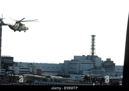 The Chernobyl nuclear power plant after the disaster of April 26 1986 Emergency helicopters gauging radiation and - Stock Photo