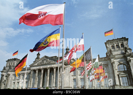 Flags outside the Reichstag as the German Democratic Republic and the Federal Republic of Germany were reunited - Stock Photo