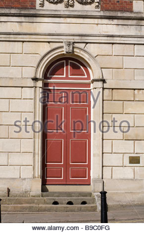 large red doors on building located in Eton Berkshire - Stock Photo