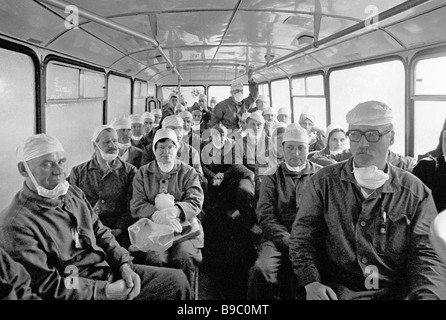 Group of decontamination specialists makes for the site of the Chernobyl Nuclear Power Plant accident which happened - Stock Photo