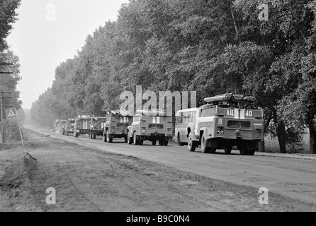 Special trucks convoy makes for the Chernobyl Nuclear Power Plant accident site to do decontamination work - Stock Photo