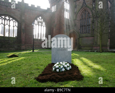 A mock gravestone erected by the Christian Aid charity to represent the people killed by the effects of climate - Stock Photo