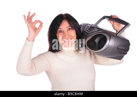 Woman with radio gives gesture OK - Stock Photo