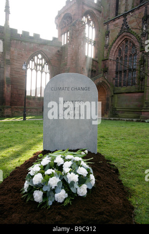 A mock gravestone erected by the Christian Aid charity to symbolize the people killed by the effects of climate - Stock Photo