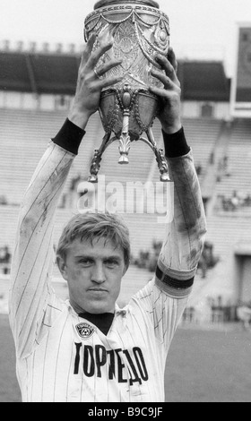 Captain of TORPEDO Moscow football club Sergei Prigoda holding the USSR Cup won in the championship - Stock Photo