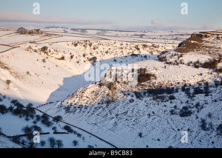 Early morning in Cressbrook Dale after a fall of snow, Peak District, Derbyshire - Stock Photo