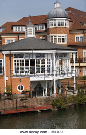 restaurant and luxury flats riverside Eton Berkshire overlooking the River Thames - Stock Photo
