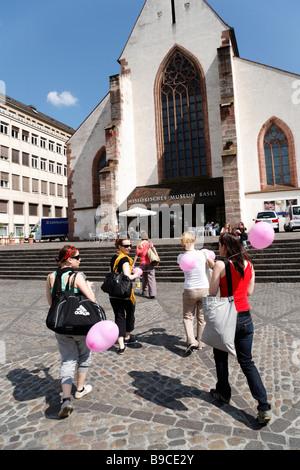Group of women arriving Historical Museum Barfüsserkirche Franciscan church Barfüsserplatz barefoot square Basel - Stock Photo