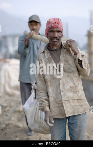 Indian workers in Bhutan working on the new complex in Thimphu. - Stock Photo