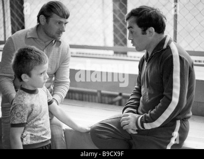Ali Aliyev right five time world champion in free style wrestling with his pupil Magomed Ramazanov left - Stock Photo