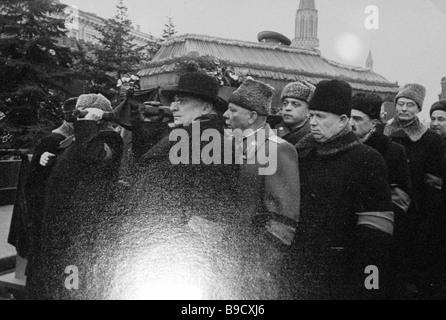 From left to right Lavrenty Beria Kliment Voroshilov Nikita Khrushchev Anastas Mikoyan and Mikhail Suslov carry - Stock Photo
