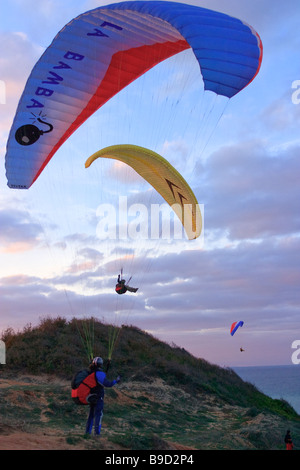 Three paraglider pilots in Ormanli at dusk Black Sea coast of Istanbul aerial view Turkey - Stock Photo
