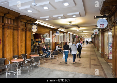 Shops and cafe in the Royal Exchange Arcade in the city centre, Manchester, England - Stock Photo