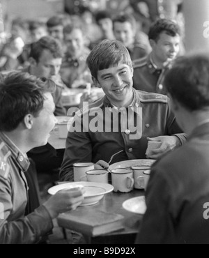 Cadets of the Moscow Mossovet Border Guards Command Higher School of the USSR KGB in the canteen - Stock Photo