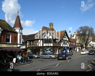 Traffic and shops looking north in the High Street, Haslemere, Surrey, England, Great Britain, United Kingdom, UK, - Stock Photo