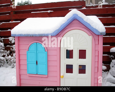 Childs playhouse in snow - Stock Photo
