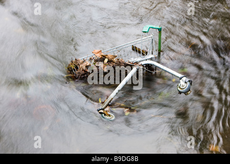 United Kingdom Discarded Shopping Trolley in A River - Stock Photo