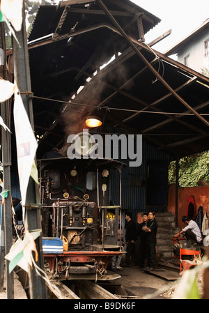 Steam engine in a workshop, Darjeeling Himalayan Railway, Darjeeling, West Bengal, India - Stock Photo