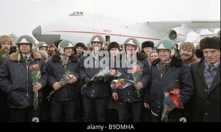 An air crew receives congratulations after an AN 225 Mriya Dream super heavy cargo jet finished its maiden test - Stock Photo
