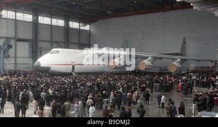 The AN 225 Mechta Dream super heavy cargo jet emerges on the landing strip - Stock Photo