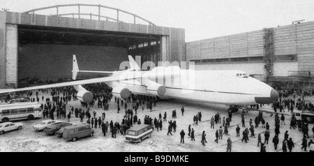 The AN 225 Mechta Dream super heavy cargo jet emerges on the landing strip - Stock Photo