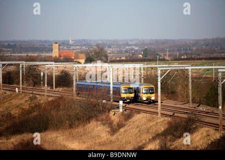First Capital Connect 365520 365531 High Speed Electric Trains Woodwalton East Coast Main Line Railway Cambridgeshire - Stock Photo