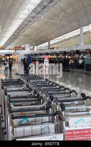 Luggage Trolleys At Chek Lap Kok International Airport, Hong Kong - Stock Photo