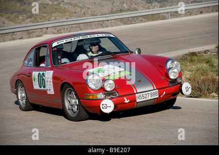 Red 1968 Porsche 911 S Racing in the Classic car rally Mallorca - Stock Photo